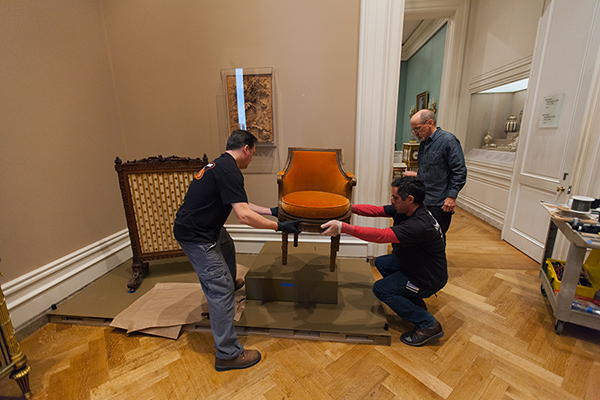 Getty Museum preparators moving Marie-Antoinette's armchair
