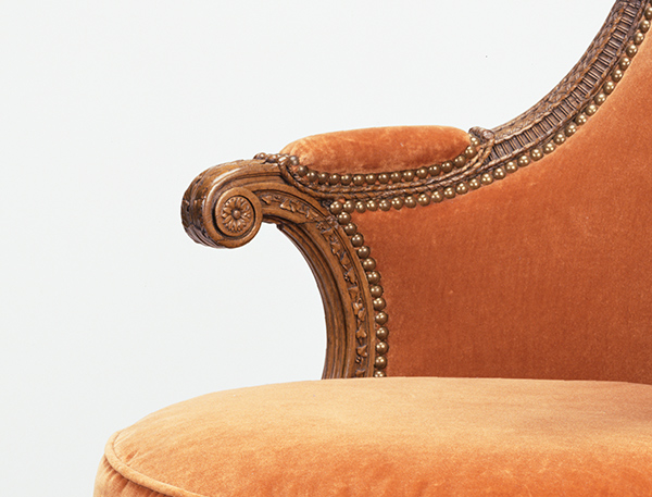 Carved floral decoration on the arms of Marie-Antoinette's armchair