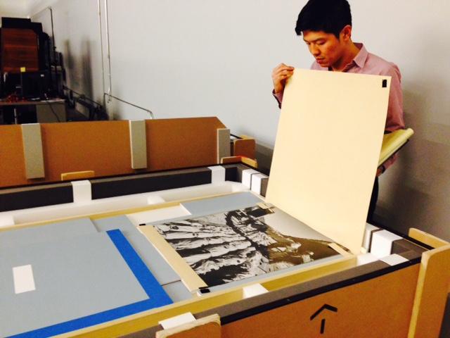 Curator John Tain with Shunk-Kender materials