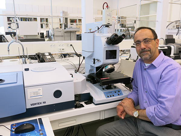 Portrait of scientist Herant Khanajian in a Getty Conservation Institute lab with an FTIR machine