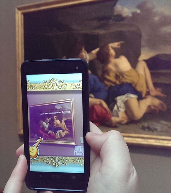 Play testing the game Getty ARtPG, which used augmented reality to overlay a story onto works of art. Created by Steven Li, Theodore Park, Aditya Radhakrishna, and Kyle Vaidyanathan