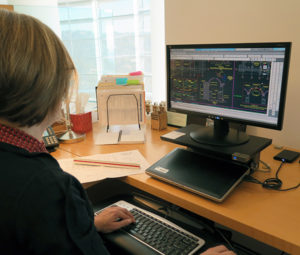 Sara Lardinois, project specialist at the Getty Conservation Institute, works on a CAD drawing