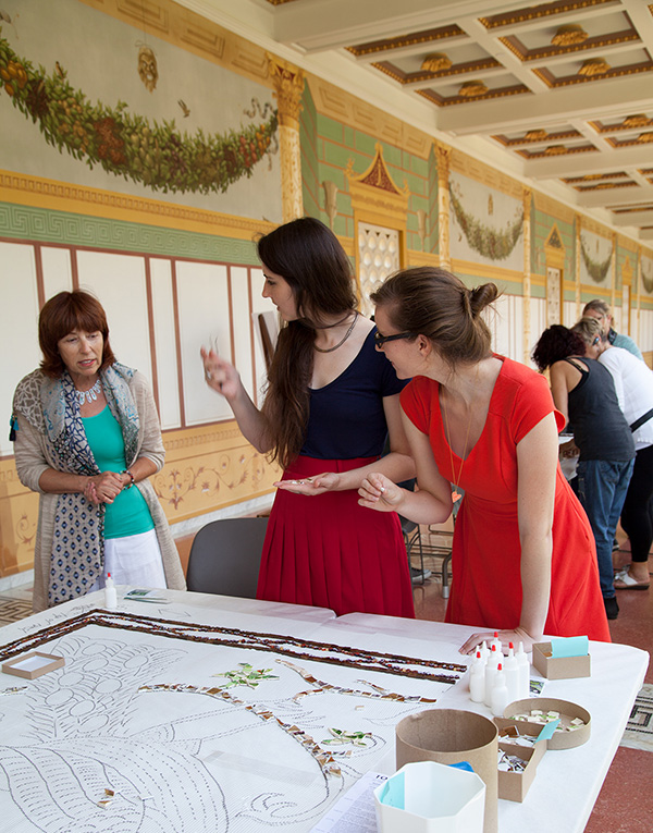 Artist Karen Silton talking to two visitors at the Getty Villa
