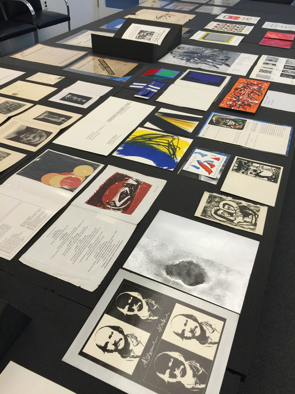 Examples of original artworks and graphic designs in the Arntz collection, including works by Dieter Hacker, Hans Hartung, Alexander Hatzl, Raoul Hausmann, Erich Heckel, Ewald Matare, Will Sohl, Victor Vasarely, and Frank Avray Wilson. The Getty Research Library, Wilhelm Arntz collection of rare exhibition catalogs and printed ephemera, 2003.M.13.