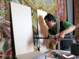Vincent Beltran uses a microfading tester on a tapestry from the Getty Museum's collection