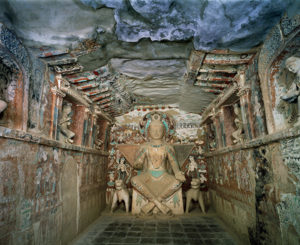 Interior and sculpture of a bodhisattva in Cave 275 / Cave Temples of Dunhuang
