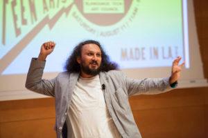 Mario Ybarra, Jr., delivering a keynote at the Getty
