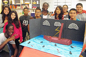 Students with a model of the set for Homer's Odyssey