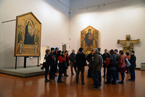 Conservators in a panel paintings gallery at the Uffizi Gallery