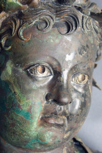 Detail of patina on a Roman bronze statue of Cupid