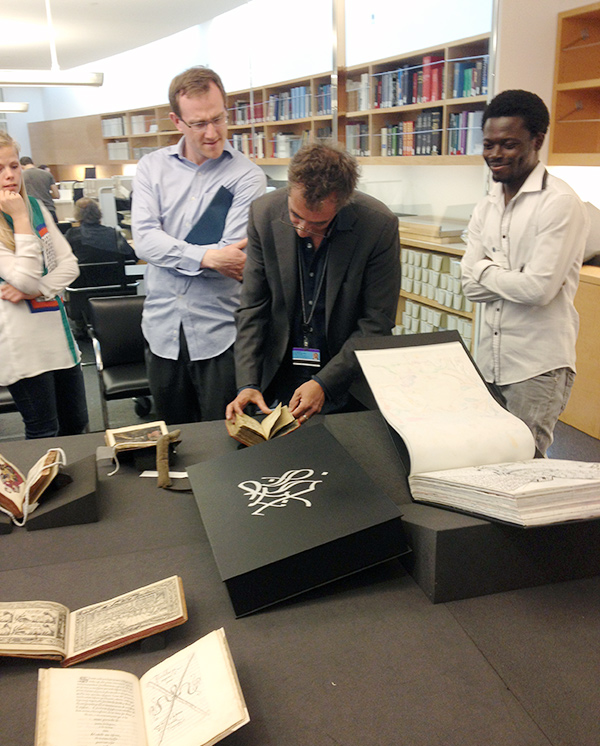 Students examine rare books at the Getty Research Institute
