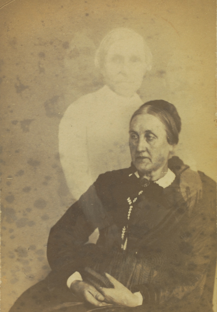 "Unidentified elderly woman seated, three ""spirits"" in background, 1862-1875, William H. Mumler. Albumen silver print. The J. Paul Getty Museum. 84.XD.760.1.19"