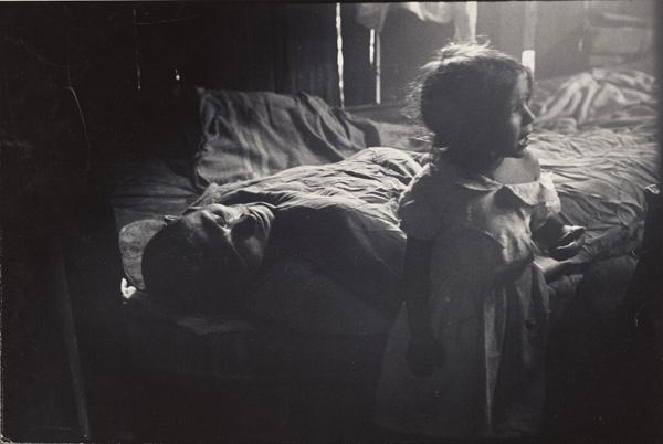 Flavio: Isabel beside Sick Father, Rio de Janeiro, Brazil / Gordon Parks