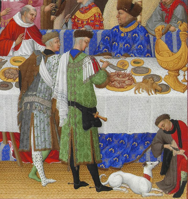 Detail of dogs in an illumination from the Tres Riches Heures du Duc de Berry
