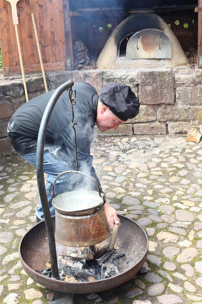 Author cooking broth outdoors