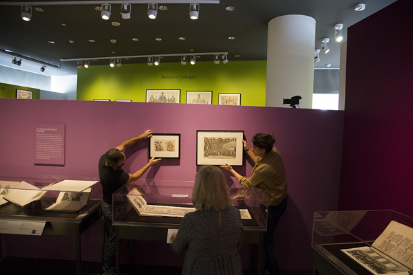 Installing a new acquisition (at left on wall) at the Getty Research Institute
