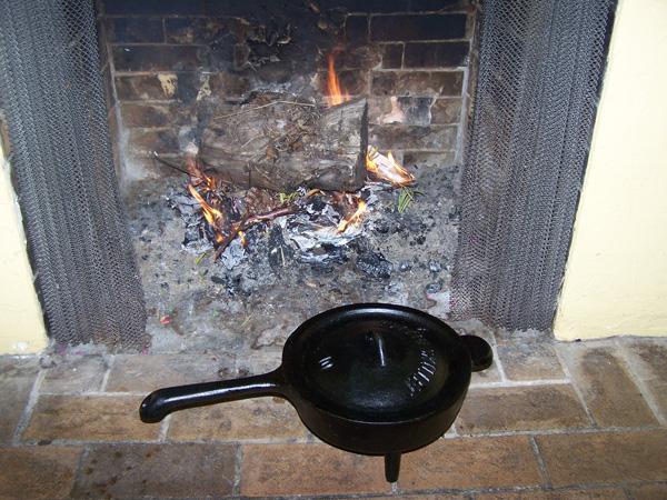 An iron pot with legs
