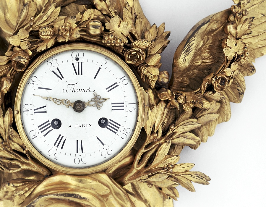 Wall Clock - detail of face and gilded ornament / French