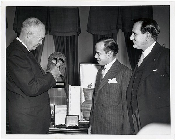 President Dwight D. Eisenhower receives ancient artifacts from Prime Minister Spyros Markezinis.