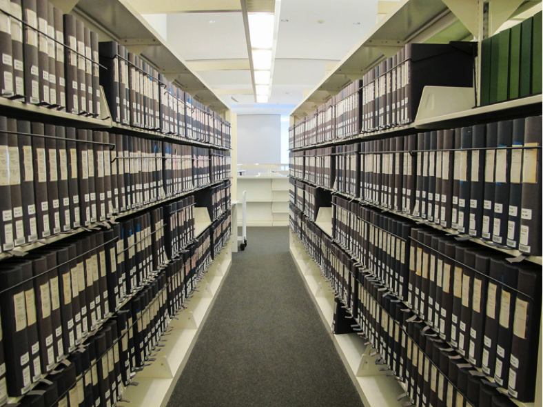 View of aisle of shelves filled with archival boxes in the Photo Archive of the Getty Research Institute