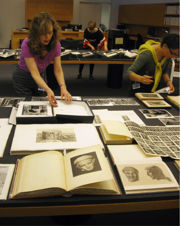 Archivist Tracey Schuster working with photo archival materials in the special collections reading room at the Getty Research Institute