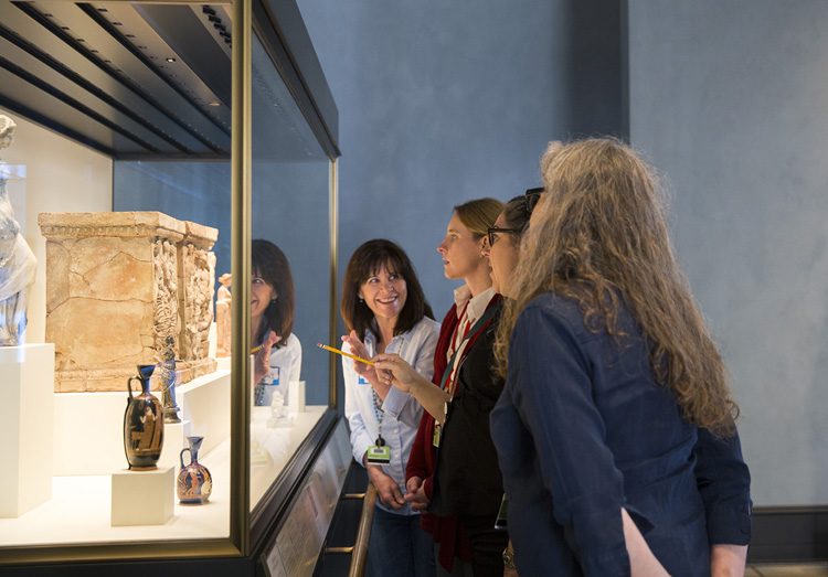 Getty educators discuss objects in a Getty Villa display case