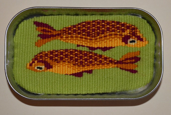 """Fish in a Tin Can #1."" Part of a series I'm working on now. Cotton warp, wool and mercerized cotton weft. 2 ¼ in. x 4 in. Photo: Yadin Larochette"