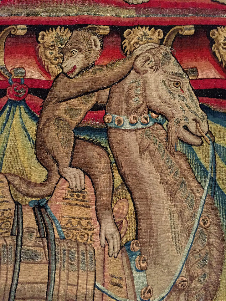 Monkey and camel in a tapestry of the Triumph of Bacchus