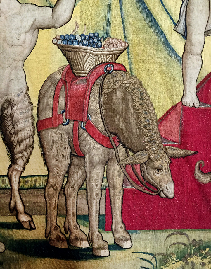 Donkey bearing grapes in a tapestry of the Triumph of Bacchus