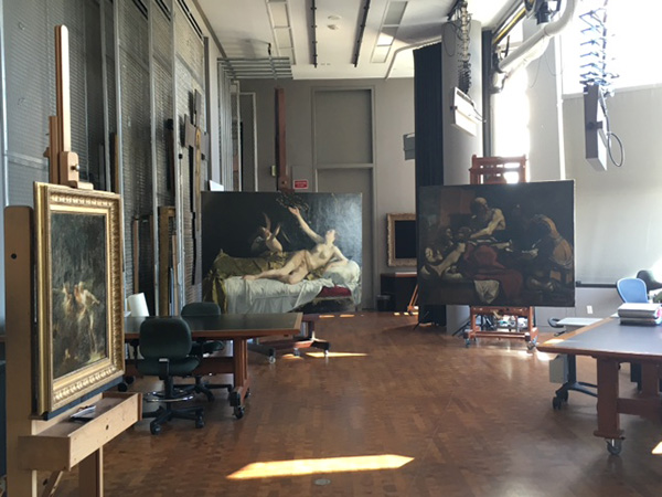 Paintings on easels stand in the Getty Museum's Paintings Conservation studio