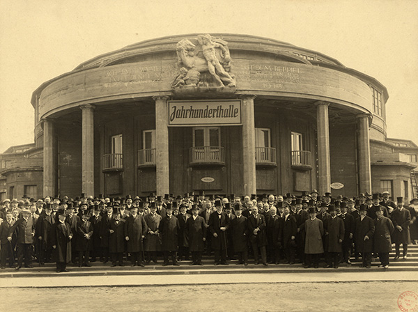 People pose outside Centennial Hall during the opening ceremony of the Centennial Exhibition, May 1913