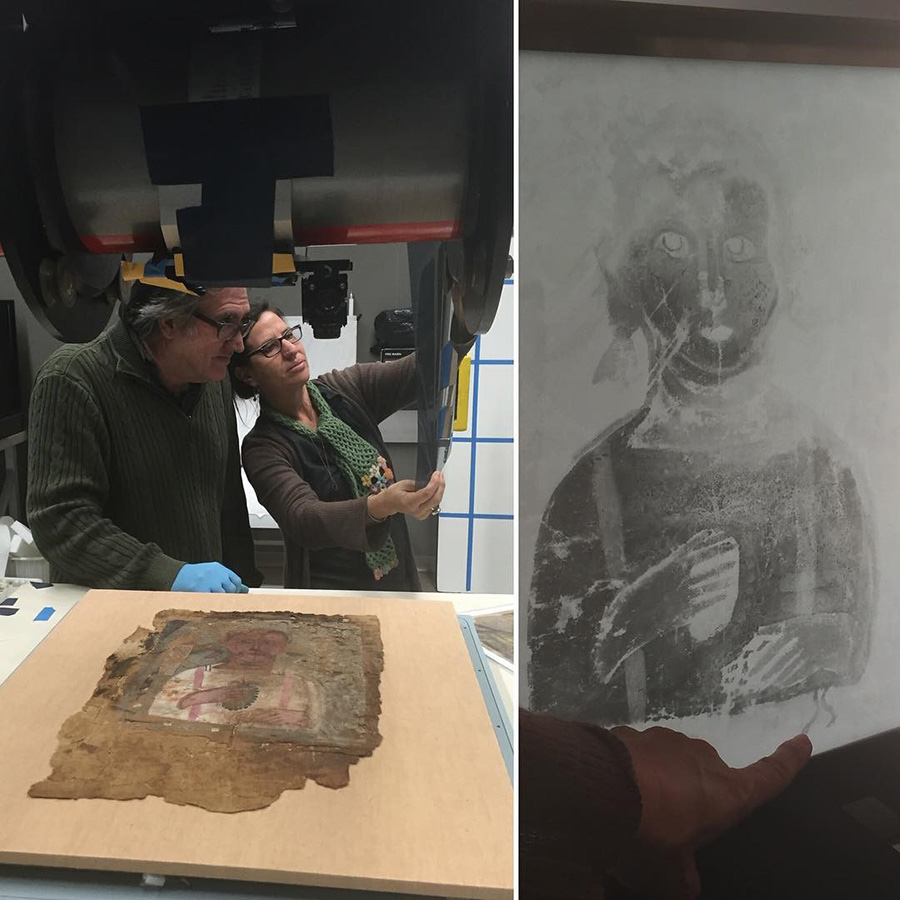 Getty Museum associate conservators Jeffrey Maish and Marie Svoboda examine an X-ray created by electron emission of a mummy shroud