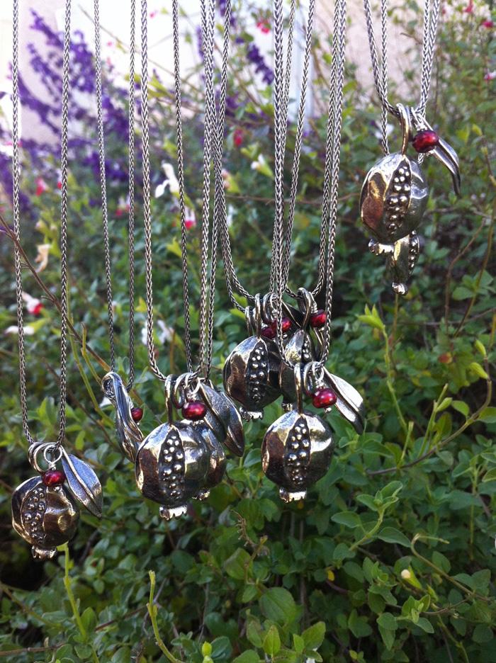 Silver pomegranate jewelry designed by Jivita Harris-Casey