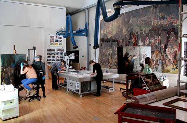 Conservators treat paintings in one of the National Gallery of Ireland's conservation studios