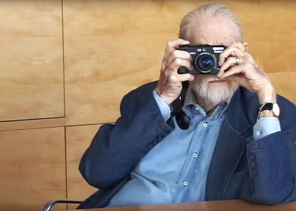 Artist Charles Brittin takes a photo during an interview at the Getty.