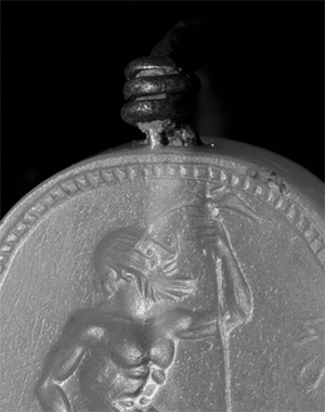 Engraved scaraboid gem inset into a ring, about 470 B.C., Unknown. Greek. Ring: silver; gem: blue chalcedony. 11/16 x 9/16 x 5/16 in. The J. Paul Getty Museum. 84.AN.1.12