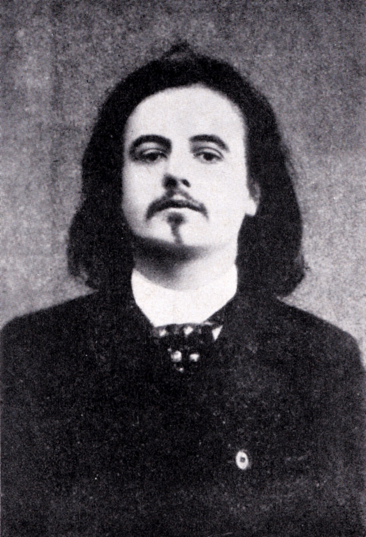 Photograph of Alfred Jarry, attributed to the studio of Nadar, taken around the time of the original performance of Ubu Roi.