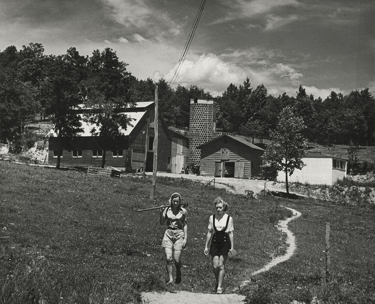 Students walking toward Black Mountain College barn and silo, n.d.
