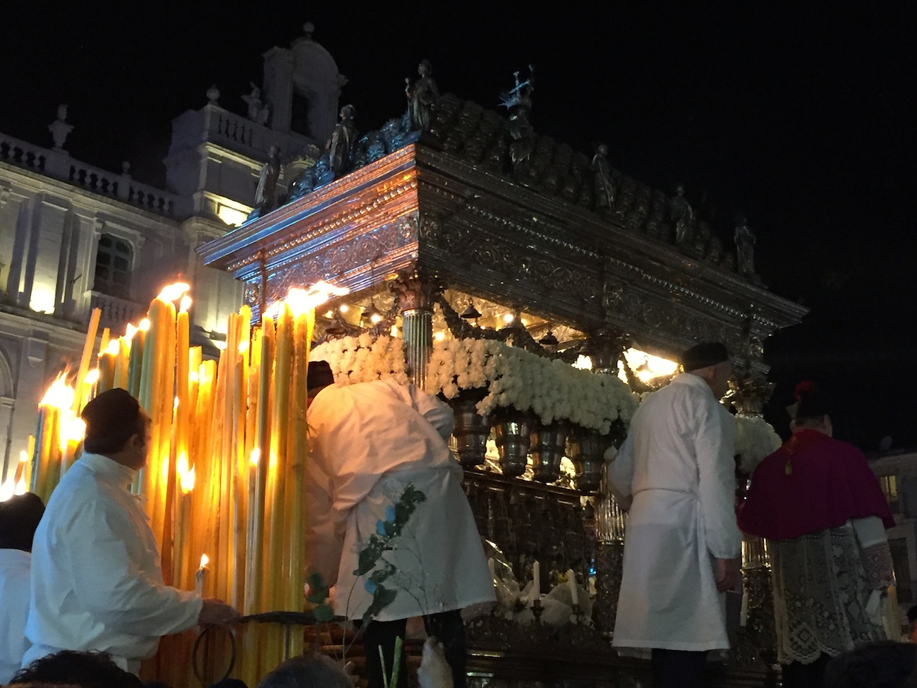 Carriage with St. Agatha's silver casket illuminated by candles