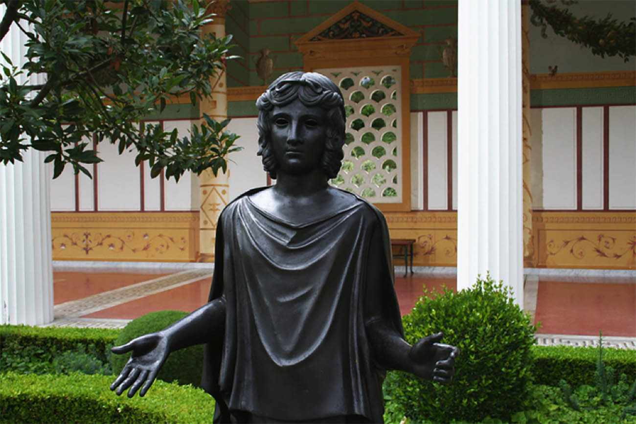 Bronze sculpture of a praying woman in the Getty Villa's Outer Peristyle.
