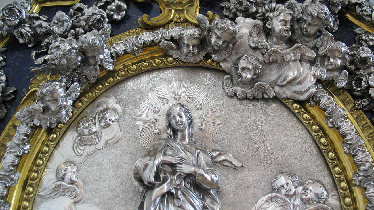 Detail of a silver wall plaque representing the Virgin of the Immaculate Conception