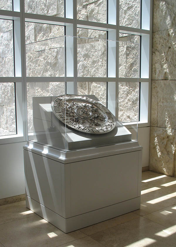 Showcase with a silver basin representing scenes from the life of Antony and Cleopatra
