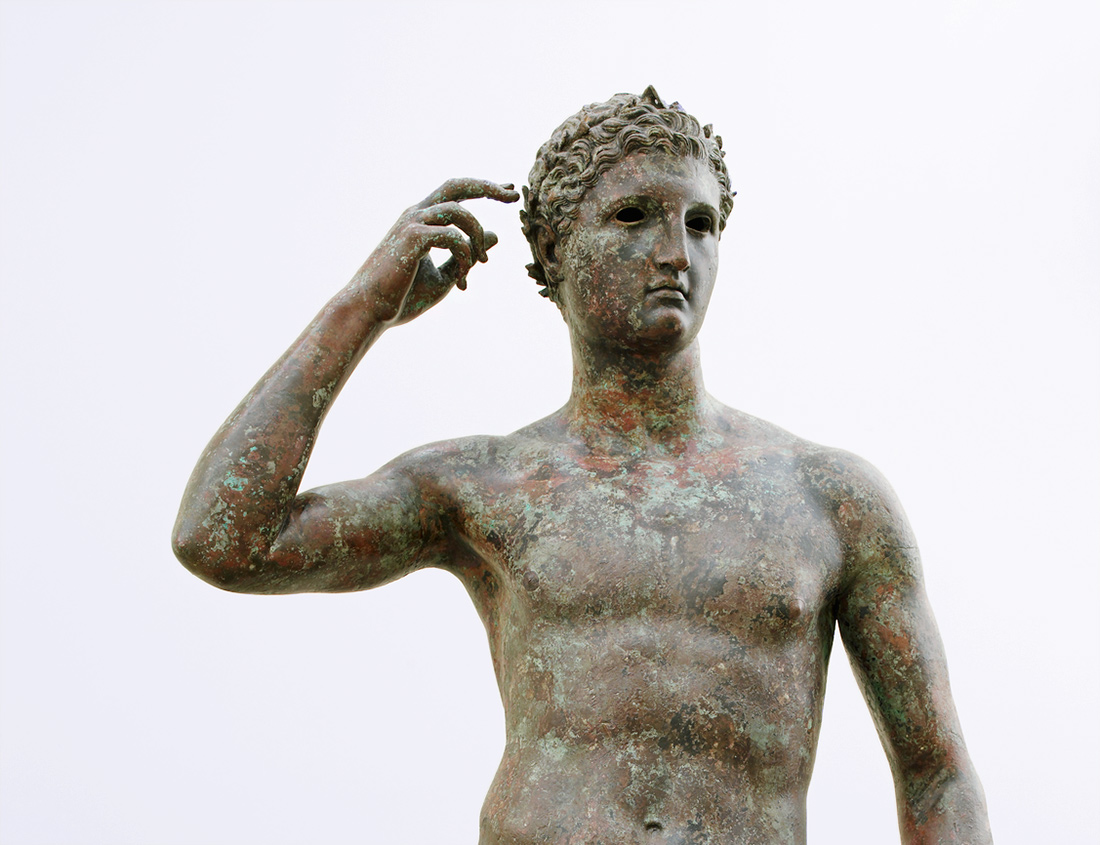 Statue of a Victorious Youth (detail of torso and head) / Greek