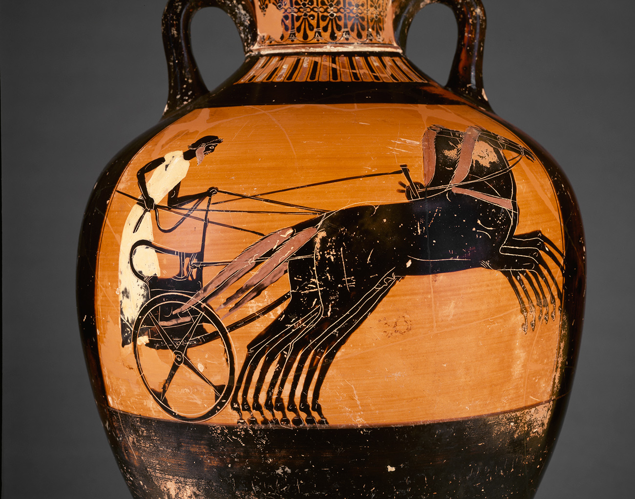 Vase painting showing a charioteer racing to victory in a four-horse chariot