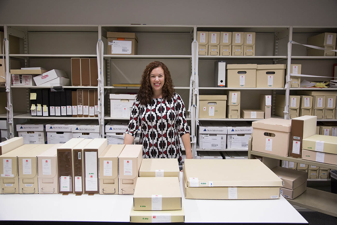 Institutional archivist Sara Seltzer amidst boxes from the J. Paul Getty Trust Institutional Archives.