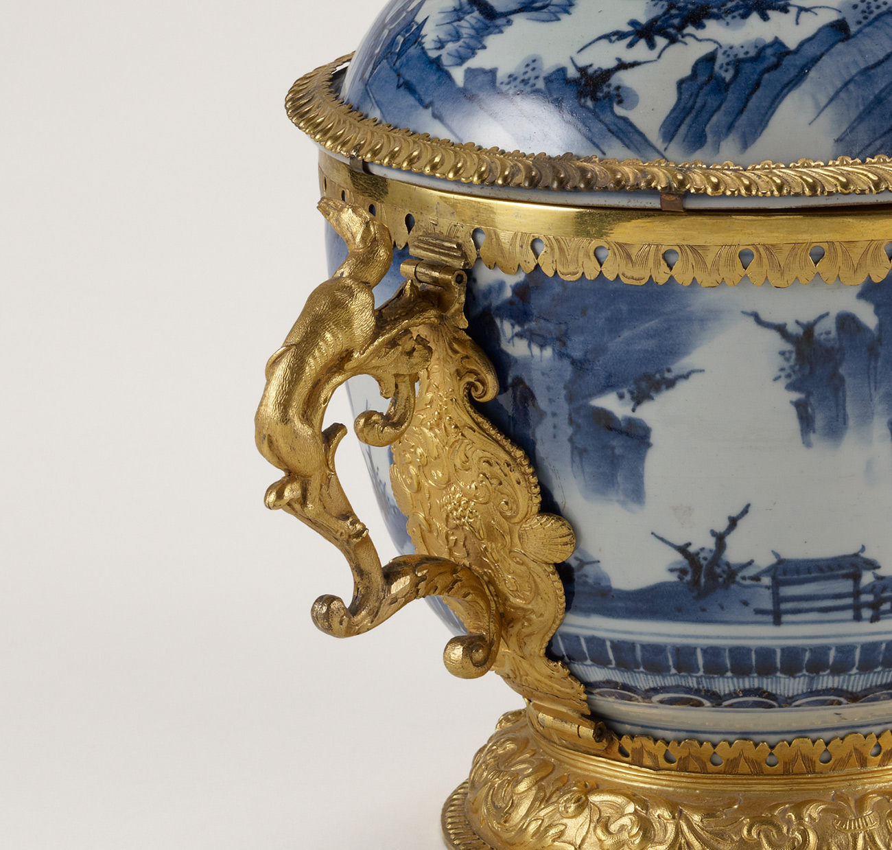 Detail of gilt-bronze handle on bowl
