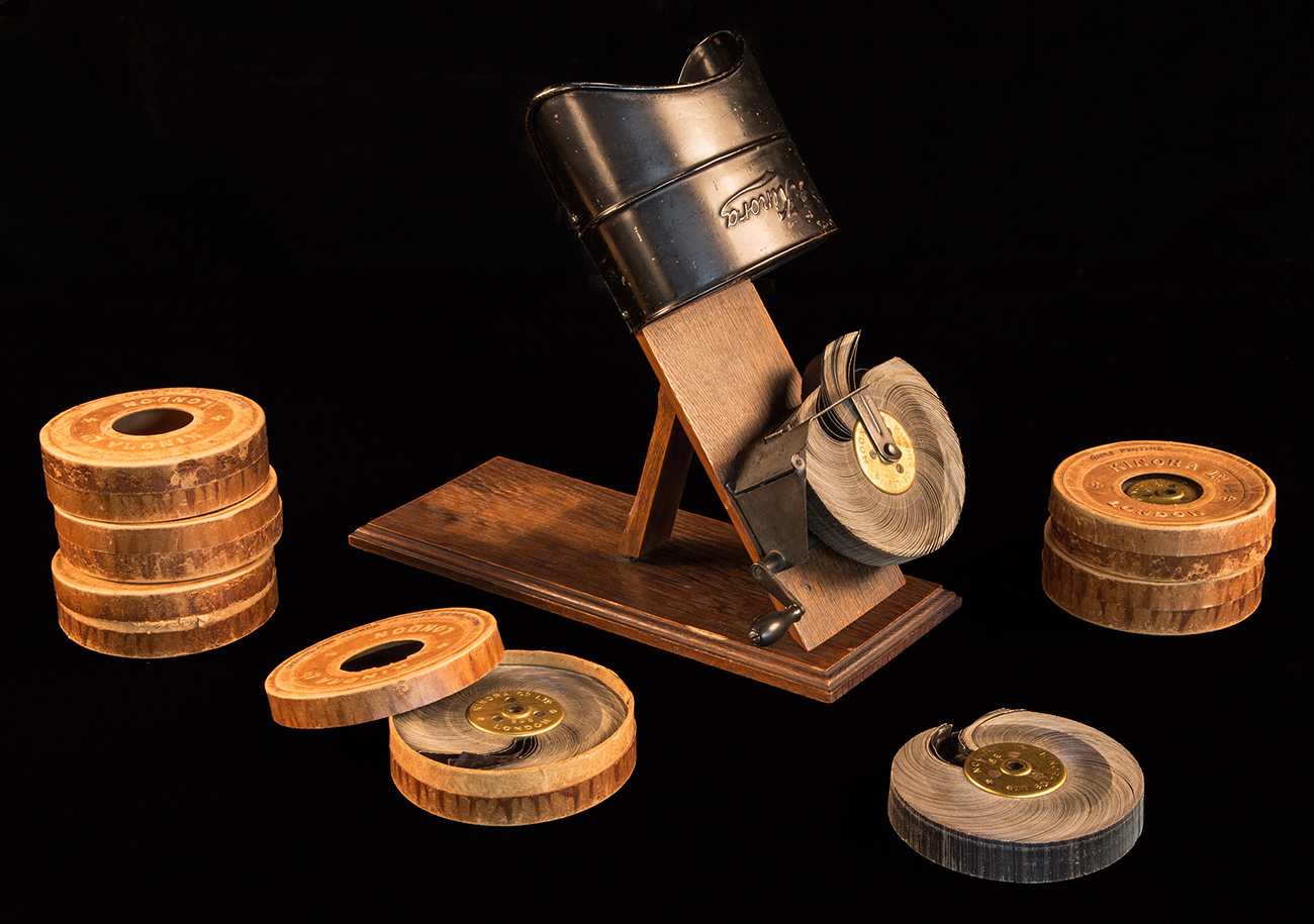 Kinora viewer and six reels in their original housings
