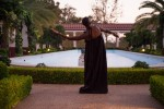 As dusk falls, taisha paggett dances near the fountain in the Getty Villa's Outer Peristyle Garden.