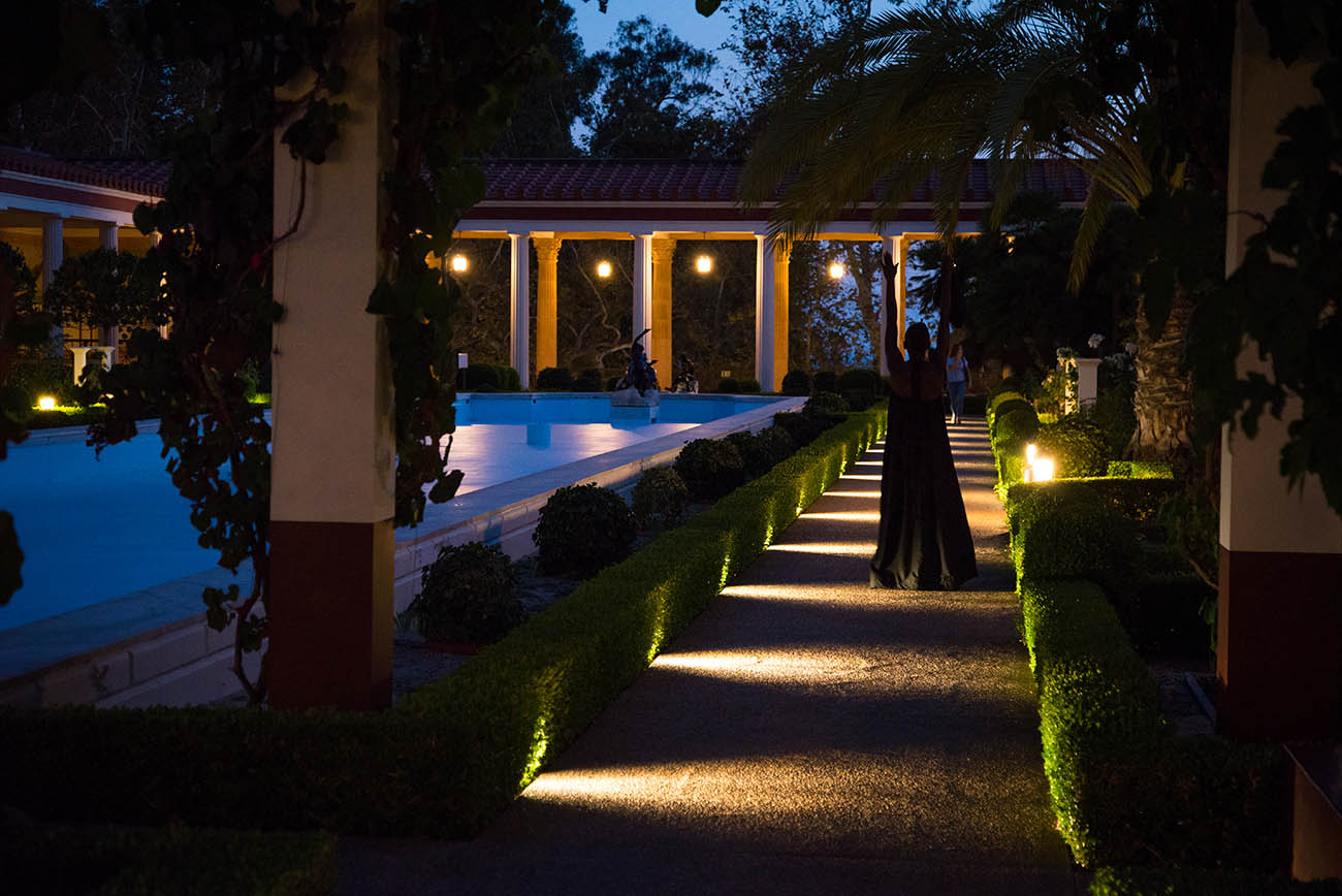 At night, taisha paggett dances near the fountain in the Getty Villa's Outer Peristyle Garden.