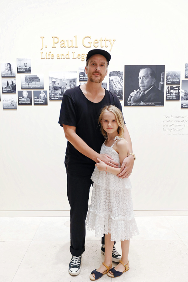 Balthazar Getty and his daughter, June, stand in the J. Paul Getty: Life & Legacy installation at the Getty Center.